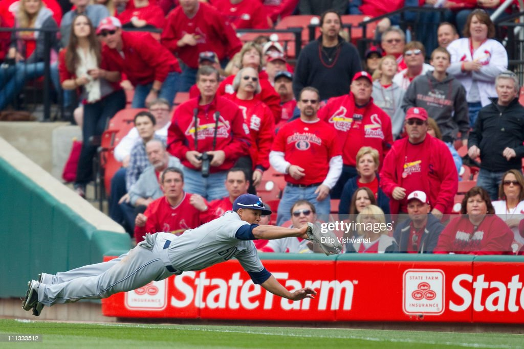 Will Venable of the San Diego Padres catches a fly ball against the St Louis Cardinals on opening day at Busch Stadium on March 31 2011 in St Louis...