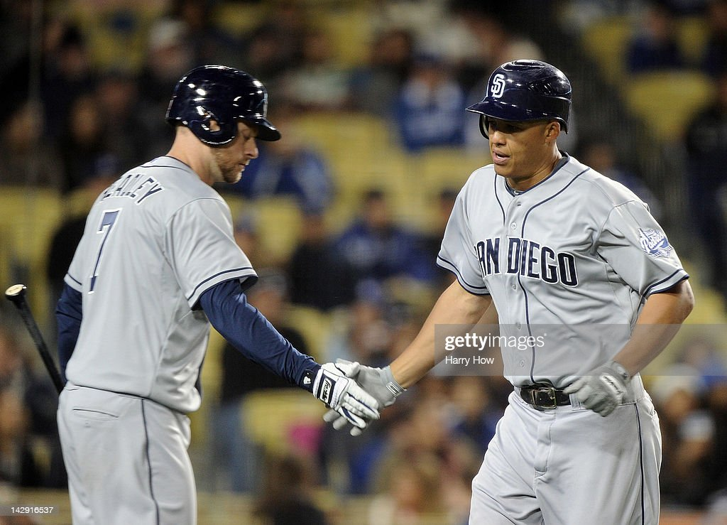 <a gi-track='captionPersonalityLinkClicked' href=/galleries/search?phrase=Will+Venable&family=editorial&specificpeople=3068470 ng-click='$event.stopPropagation()'>Will Venable</a> #25 of the San Diego Padres celebrates his run with <a gi-track='captionPersonalityLinkClicked' href=/galleries/search?phrase=Chase+Headley&family=editorial&specificpeople=4353228 ng-click='$event.stopPropagation()'>Chase Headley</a> #7 during the fourth inning against the Los Angeles Dodgers at Dodger Stadium on April 13, 2012 in Los Angeles, California.