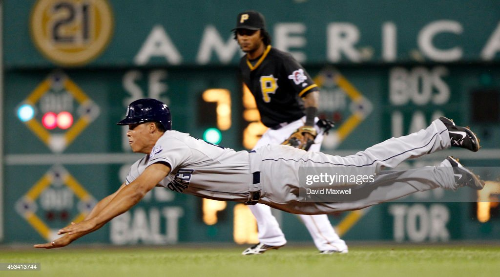 Will Venable of the San Diego Padres dives into second on a stolen base attempt during the eighth inning as Michael Martinez the Pittsburgh Pirates...