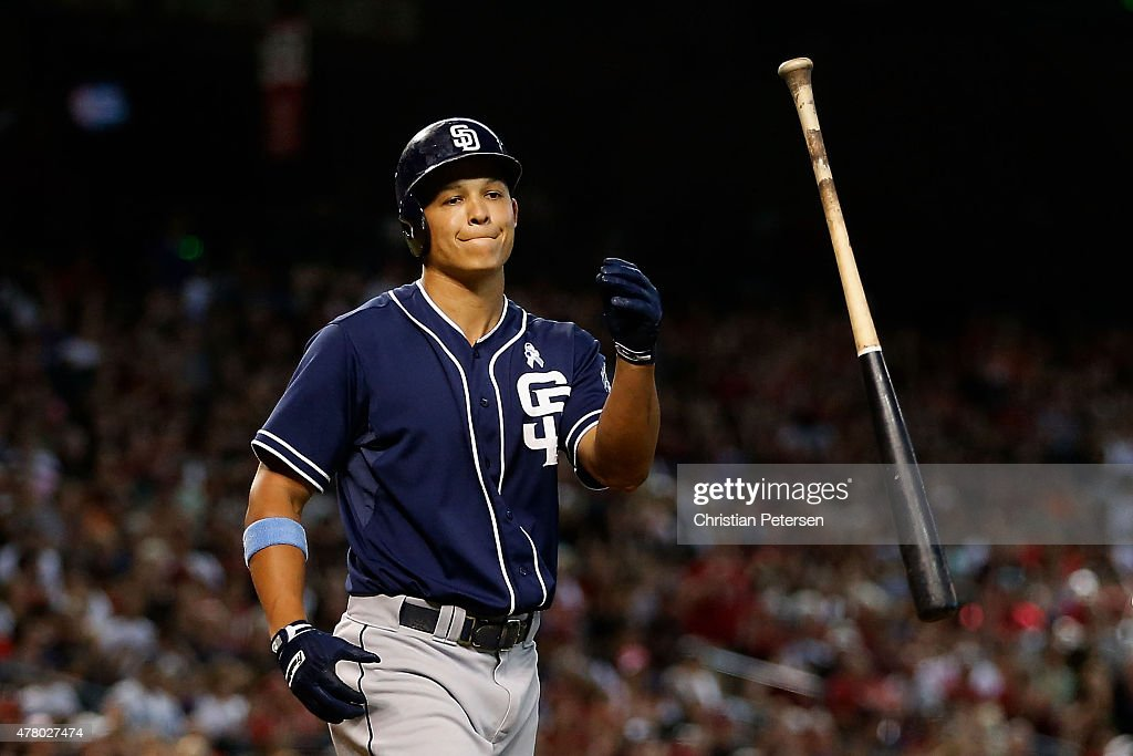 Will Venable of the San Diego Padres flips his bat after striking out against the Arizona Diamondbacks during the sixth inning of the MLB game at...