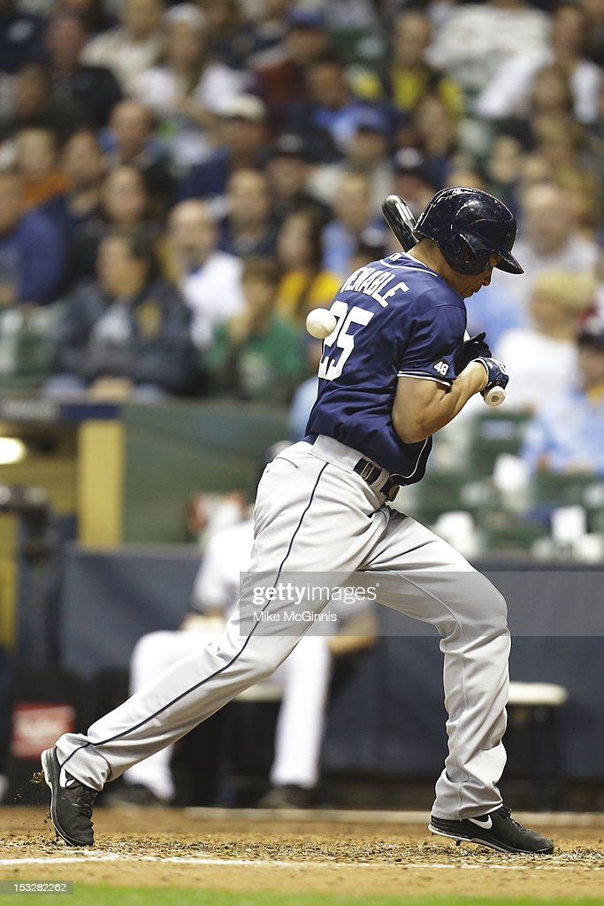 <a gi-track='captionPersonalityLinkClicked' href=/galleries/search?phrase=Will+Venable&family=editorial&specificpeople=3068470 ng-click='$event.stopPropagation()'>Will Venable</a> #25 of the San Diego Padres gets hit by a pitch from Manny Parra of the Milwaukee Brewers during the top of the sixth inning at Miller Park on October 2, 2012 in Milwaukee, Wisconsin.