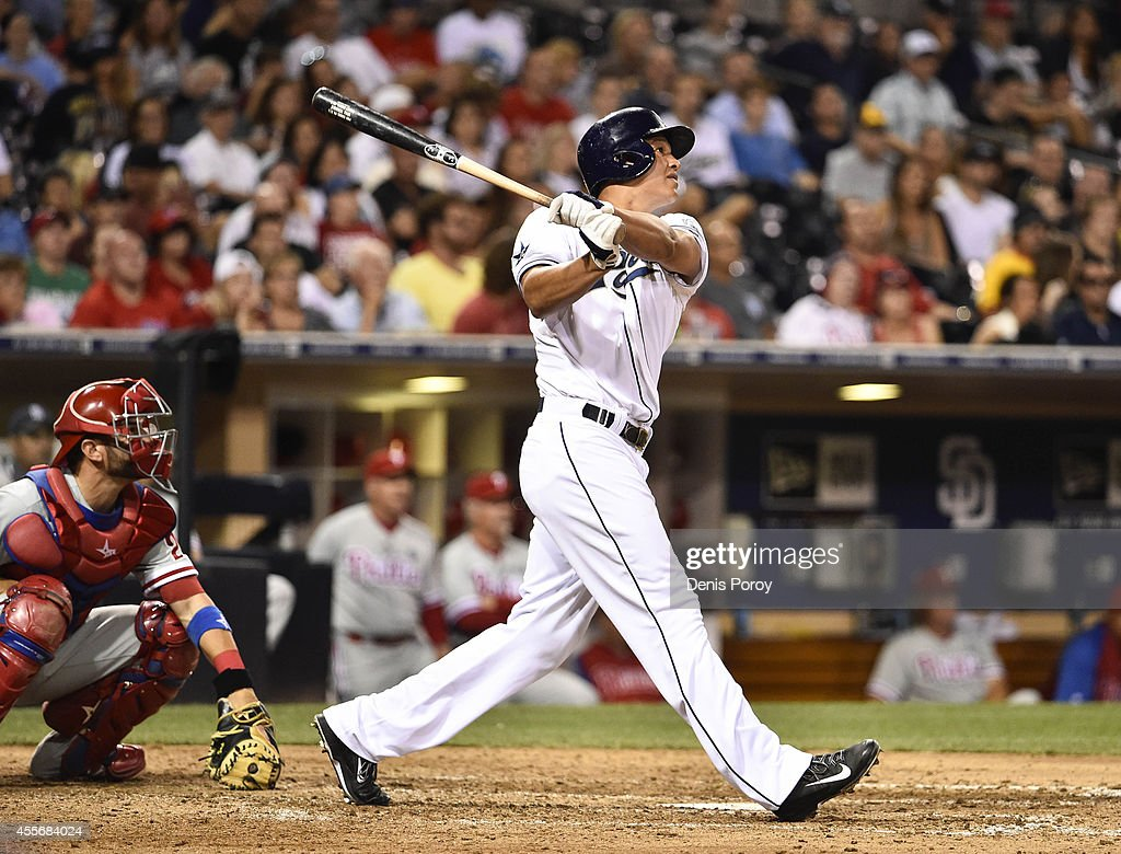 Will Venable of the San Diego Padres hits a threerun home run during the eighth inning of a baseball game against the Philadelphia Phillies at Petco...
