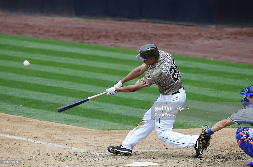 Will Venable of the San Diego Padres hits a walkoff home run during the ninth inning of a baseball game against the New York Mets at Petco Park on...