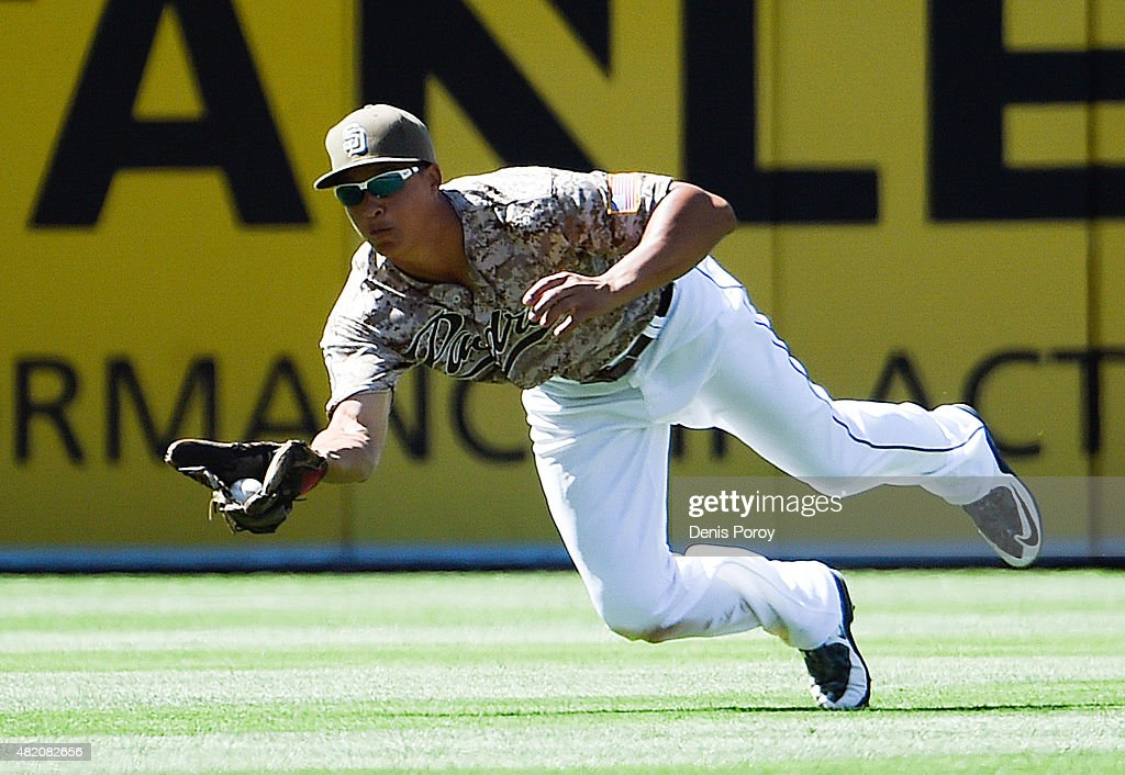 Will Venable of the San Diego Padres makes a diving catch on a ball hit by Derek Dietrich of the Miami Marlins during the ninth inning of a baseball...