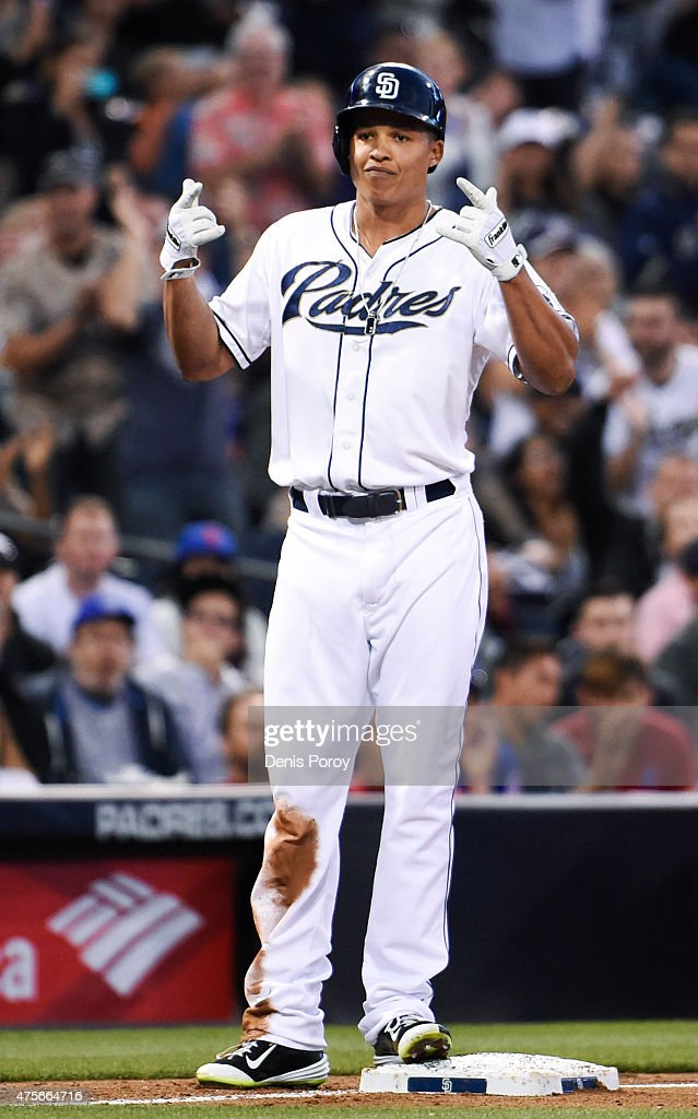 Will Venable of the San Diego Padres points after hitting an RBI triple during the second inning of a baseball game against the New York Mets at...