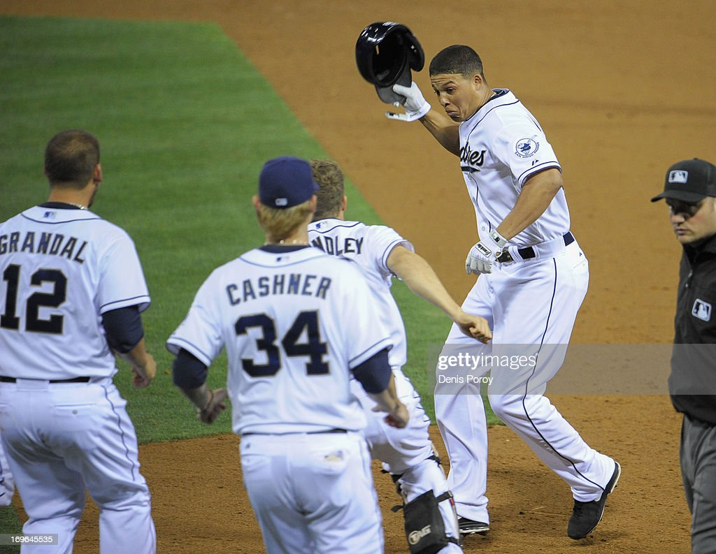 Will Venable #25 of the San Diego Padres, right, is congratulated by teammates after hitting a walk-off RBI single during the tenth inning of a baseball game against the Seattle Mariners at Petco Park on May 29, 2013 in San Diego, California. The Padres won 3-2.