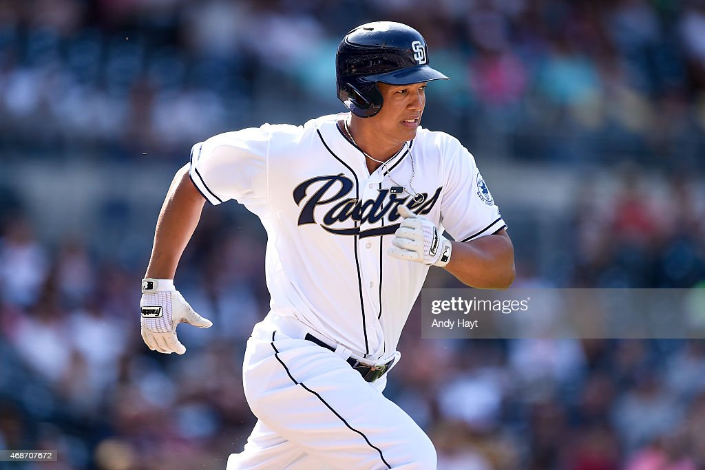Will Venable of the San Diego Padres runs to first base during the exhibition game against the Mexico City Diablos Rojos at Petco Park on April 4...