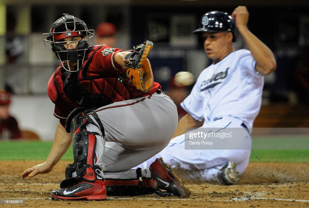 Will Venable of the San Diego Padres scores ahead of the throw to Miguel Montero of the Arizona Diamondbacks during the fifth inning of a baseball...