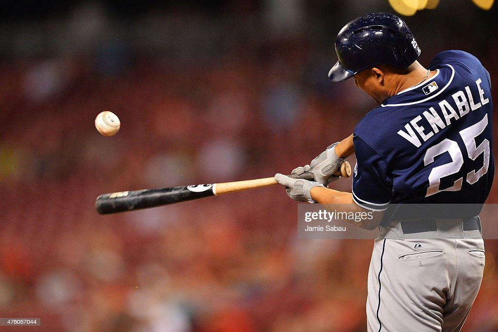 Will Venable of the San Diego Padres singles in the ninth inning against the Cincinnati Reds at Great American Ball Park on June 5 2015 in Cincinnati...