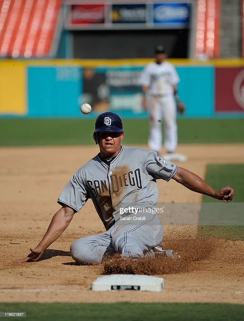 Will Venable of the San Diego Padres slides into third base during a game against the Florida Marlins at Sun Life Stadium on July 21 2011 in Miami...