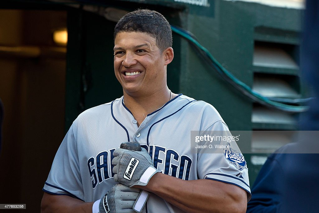 Will Venable of the San Diego Padres stands in the dugout before the game against the Oakland Athletics at Oco Coliseum on June 17 2015 in Oakland...