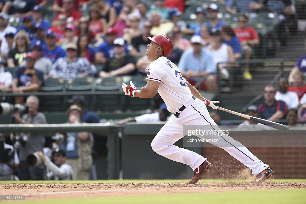 Will Venable of the Texas Rangers bats and runs to first base from the batter's box in the game against the Baltimore Orioles at Globe Life Park in...