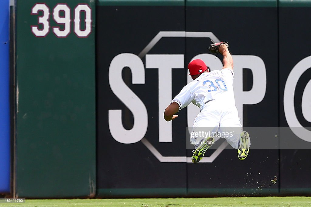 Will Venable #30 of the Texas Rangers makes a diving catch in the second inning during a game against the Toronto Blue Jays at Globe Life Park in Arlington on August 27, 2015 in Arlington, Texas.