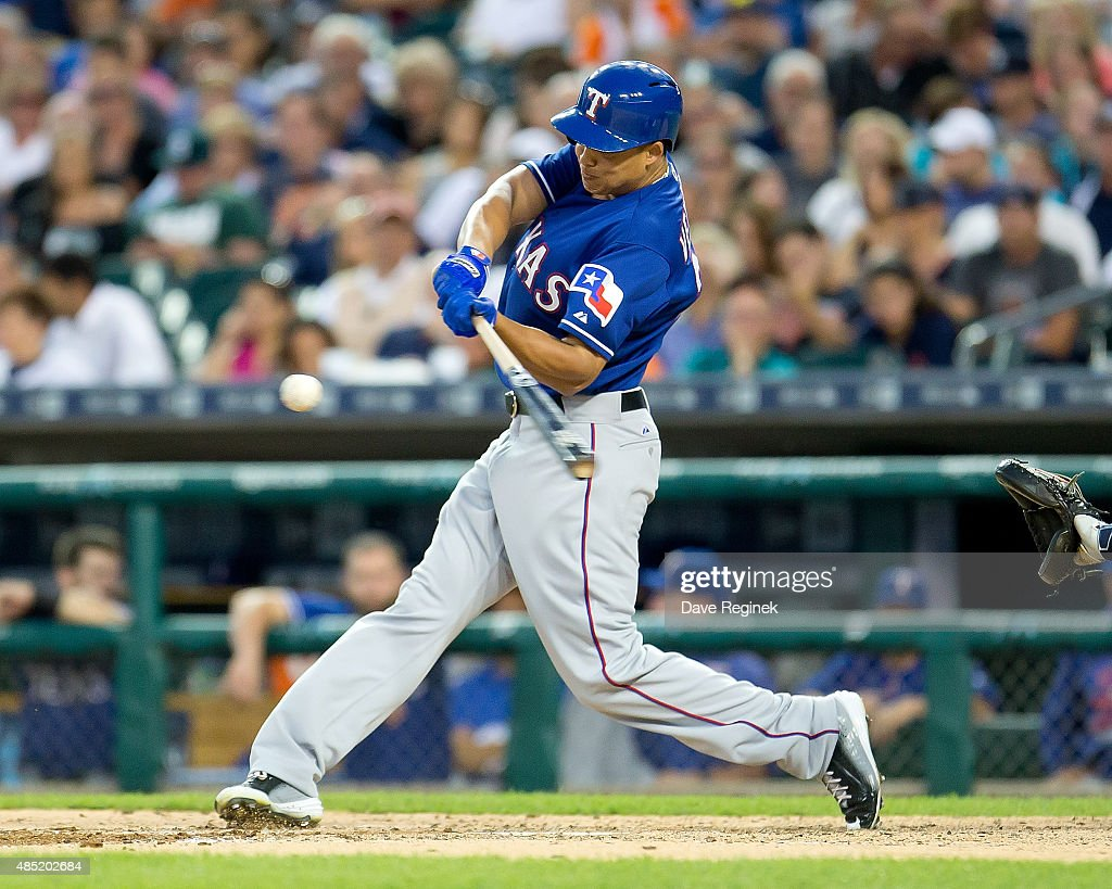 Will Venable of the Texas Rangers swings and makes contact during a MLB game against the Detroit Tigers at Comerica Park on August 21 2015 in Detroit...