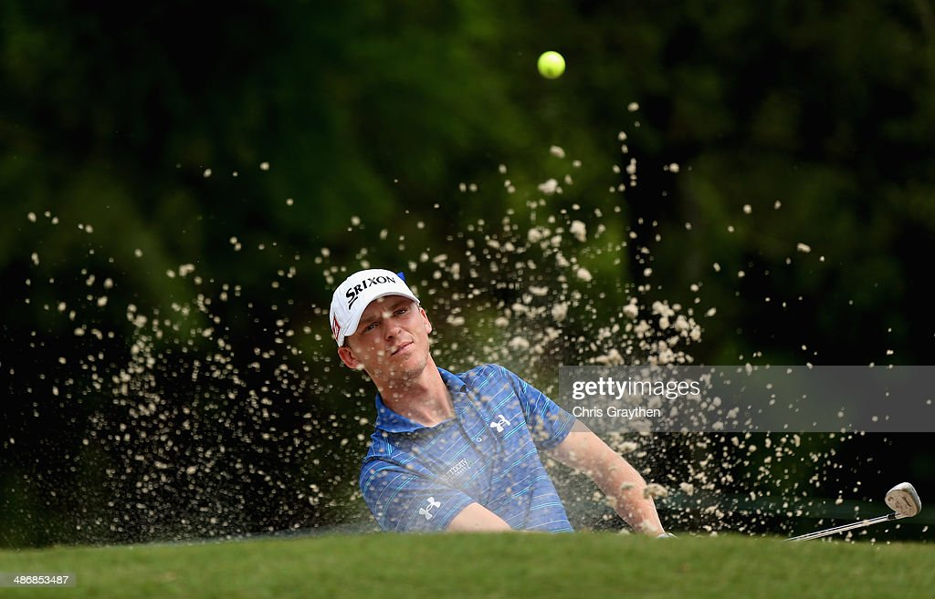 Will Wilcox chips out of the bunker on the 1st Round Three of the Zurich Classic of New Orleans at TPC Louisiana on April 26, 2014 in Avondale, Louisiana.