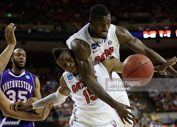 Will Yeguete and Patric Young of the Florida Gators battle each other for the ball during the second round of the 2013 NCAA Men's Basketball...