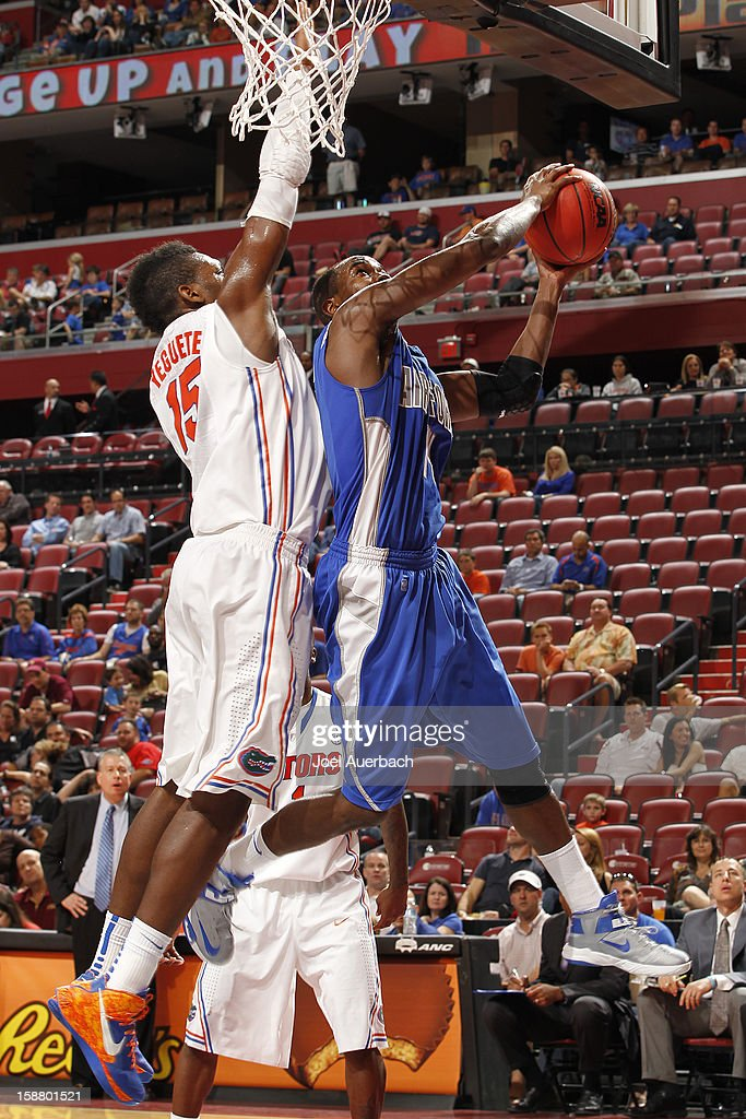 Will Yeguete #15 of the Florida Gators defends against Michael Lyons #14 of the Air Force Falcons at the MetroPCS Orange Bowl Basketball Classic on December 29, 2012 at the BB&T Center in Sunrise, Florida. The Gators defeated the Falcons 78-61.