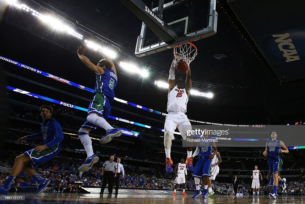 Will Yeguete #15 of the Florida Gators dunks against the Florida Gulf Coast Eagles during the South Regional Semifinal round of the 2013 NCAA Men's Basketball Tournament at Dallas Cowboys Stadium on March 29, 2013 in Arlington, Texas.