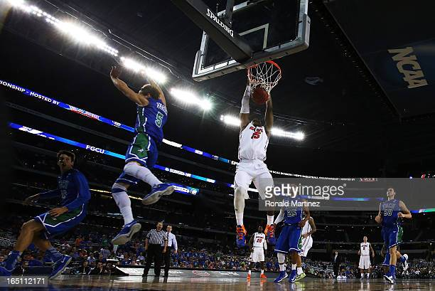 Will Yeguete of the Florida Gators dunks against the Florida Gulf Coast Eagles during the South Regional Semifinal round of the 2013 NCAA Men's...
