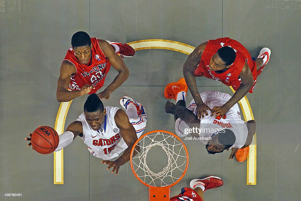 Will Yeguete #15 of the Florida Gators goes to the basket past Paul Watson #22 of the Fresno State Bulldogs during the MetroPCS Orange Bowl Basketball Classic on December 21, 2013 at the BB&T Center in Sunrise, Florida. Florida defeated Fresno State 66-49.