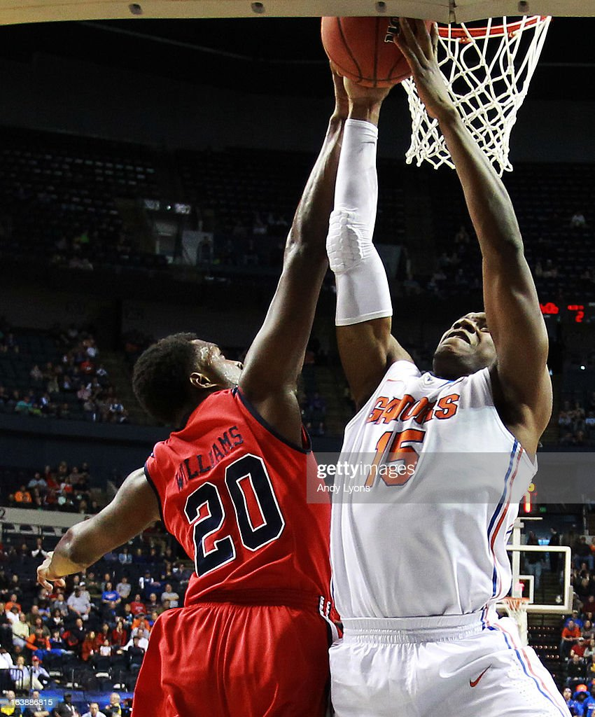 Will Yeguete #15 of the Florida Gators goes up against Nick Williams #20 of the Ole Miss Rebels in the first half of the SEC Basketball Tournament Championship game at Bridgestone Arena on March 17, 2013 in Nashville, Tennessee.