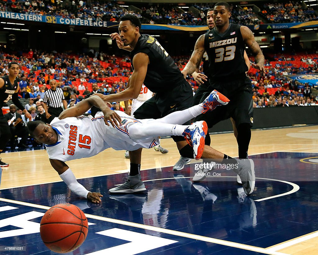 Will Yeguete #15 of the Florida Gators looses the ball out of bounds against Johnathan Williams, III #3 and Earnest Ross #33 of the Missouri Tigers during the quarterfinals of the SEC Men's Basketball Tournament at Georgia Dome on March 14, 2014 in Atlanta, Georgia.