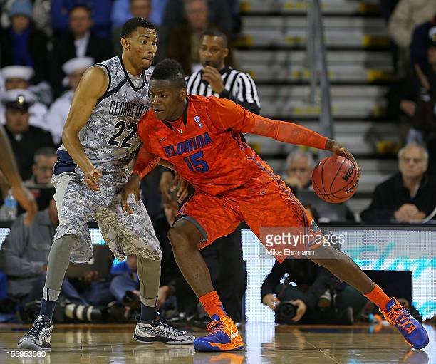 Will Yeguete of the Florida Gators posts up Otto Porter of the Georgetown Hoyas during the NavyMarine Corps Classic aboard the USS Bataan at Mayport...