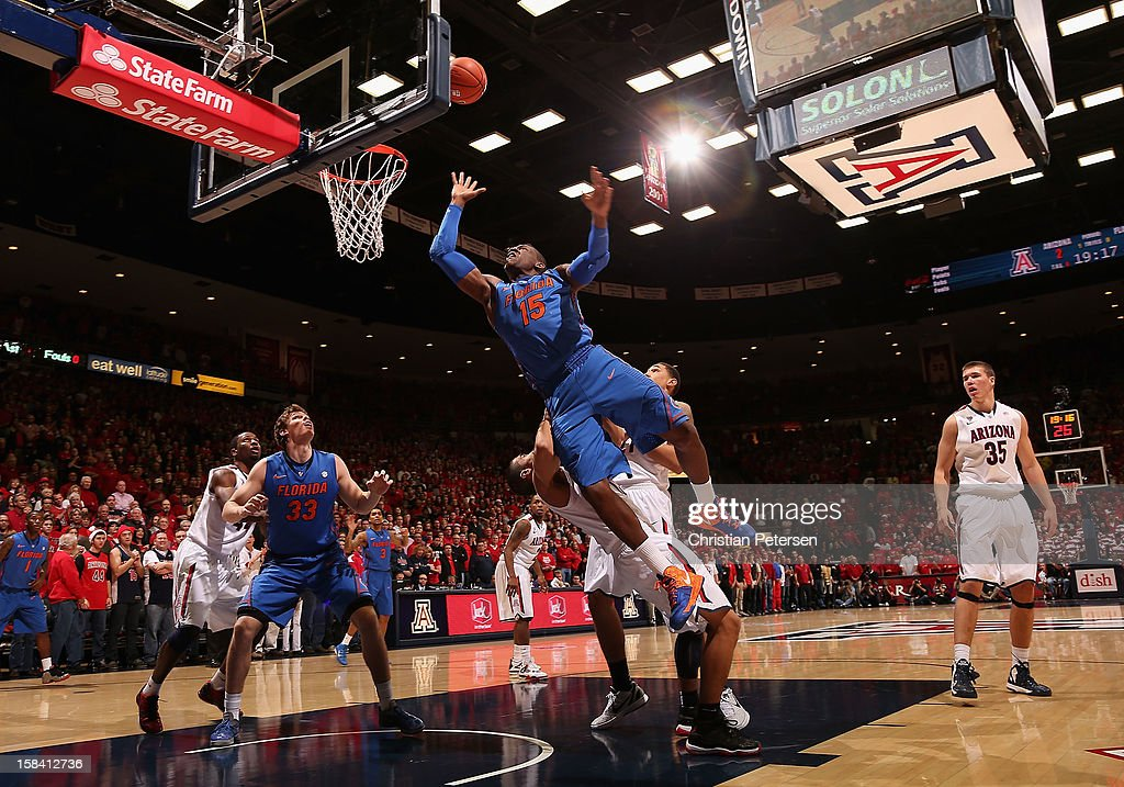 Will Yeguete #15 of the Florida Gators puts up a shot against the Arizona Wildcats during the first half of the college basketball game at McKale Center on December 15, 2012 in Tucson, Arizona. The Wildcats defeated the Gators 65-64.