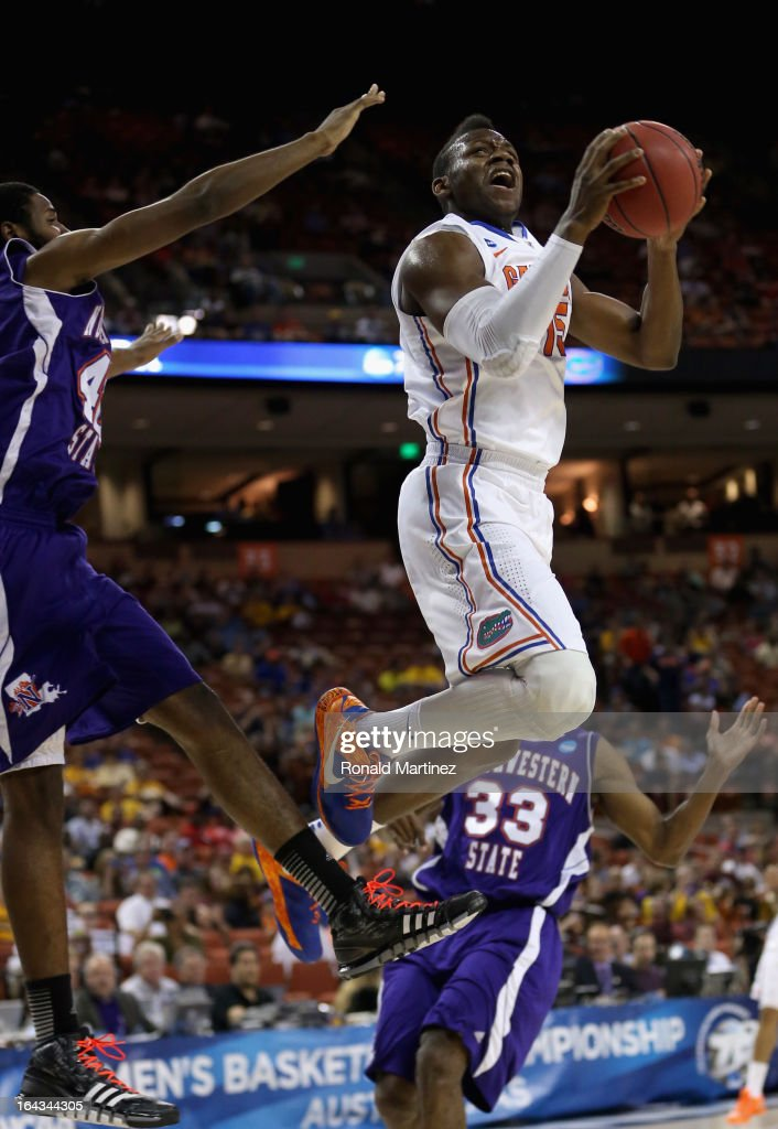 Will Yeguete #15 of the Florida Gators takes a shot against Marvin Frazier #40 of the Northwestern State Demons during the second round of the 2013 NCAA Men's Basketball Tournament at The Frank Erwin Center on March 22, 2013 in Austin, Texas.