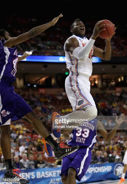 Will Yeguete of the Florida Gators takes a shot against Marvin Frazier of the Northwestern State Demons during the second round of the 2013 NCAA...