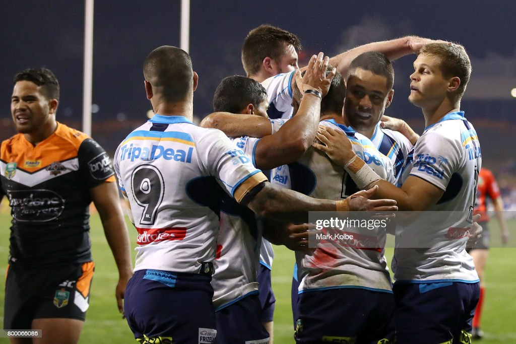 Will Zillman of the Titans celebrates with his team mates after scoring a try during the round 16 NRL match between the Wests Tigers and the Gold Coast Titans at Campbelltown Sports Stadium on June 23, 2017 in Sydney, Australia.