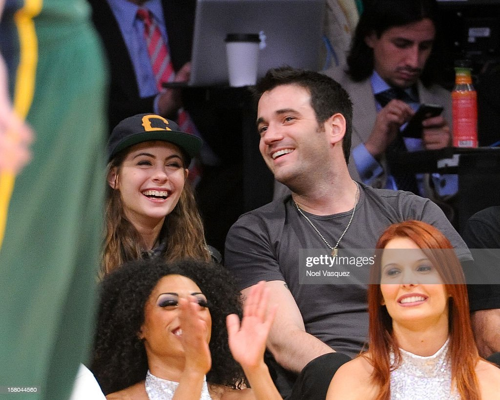 <a gi-track='captionPersonalityLinkClicked' href=/galleries/search?phrase=Willa+Holland&family=editorial&specificpeople=737113 ng-click='$event.stopPropagation()'>Willa Holland</a> (L) and Colin Donnell attend a basketball game between the Utah Jazz and the Los Angeles Lakers at Staples Center on December 9, 2012 in Los Angeles, California.