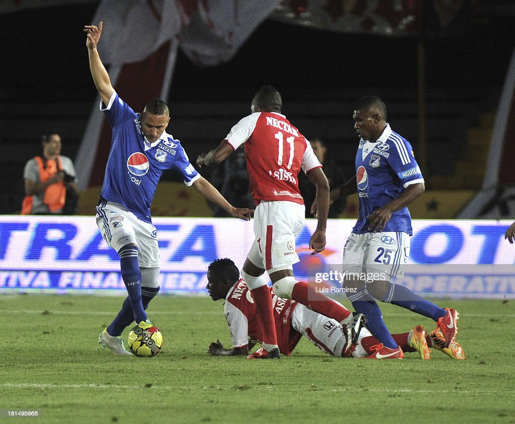Willam Zapata and Jefferson Cuero of Independiente Santa Fe fight for the ball with Anderson Zapata and Elkin Blanco of Millonarios during a match between Independiente Santa Fe and Millonarios as part of the Liga Postobon II at Nemesio Camacho Stadium on September 21, 2013 in Bogota, Colombia.