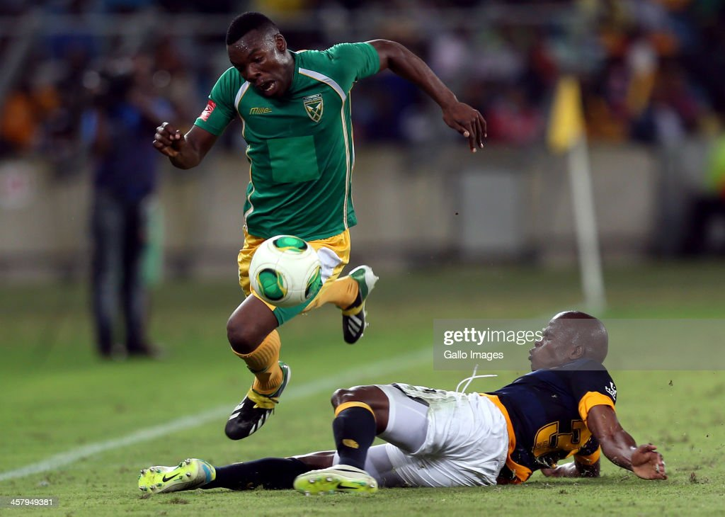 Willard Katsande of Kaizer Chiefs with a hard tackle on Siyanda Zwane of Lamontville Golden Arrows during the Absa Premiership match between Golden Arrows and Kaizer Chiefs at Moses Mabhida Stadium on December 19, 2013 in Durban, South Africa.