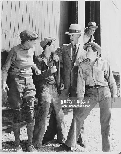Willard Robertson as the Captain of Detectives stops three runaways next to a train in the 1933 film Wild Boys of the Road The kids are Dorothy...