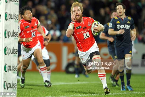 Willem Britz of the Sunwolves celebrates scoring a try during the round nine Super Rugby match between the Highlanders and the Sunwolves at Rugby...