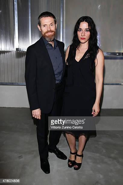 Willem Dafoe and Giada Colagrande attend the Prada show during the Milan Men's Fashion Week Spring/Summer 2016 on June 21 2015 in Milan Italy
