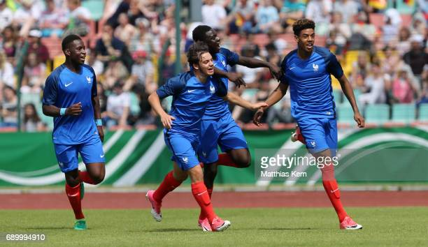 Willem Geubbels of France jubilates with team mates after scoring the first goal during the U16 international friendly match between Germany and...