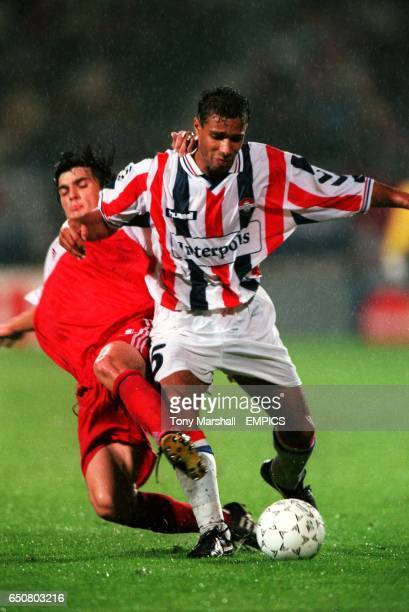 Willem II's Raymond Victoria is tackled by Artem Bezrodnyi of Spartak Moscow