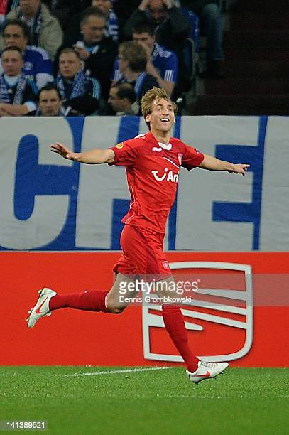 Willem Janssen of Twente celebrates after scoring his team's opening goal during the UEFA Europa League Round of 16 second leg match between FC...