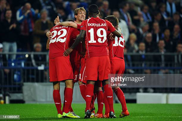 Willem Janssen of Twente celebrates with team mates after scoring his teams first goal during the UEFA Europa League Round of 16 second leg match...