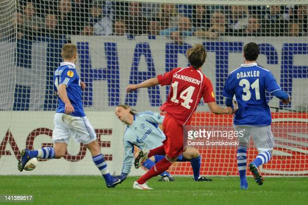 Willem Janssen of Twente scores his team's opening goal against goalkeeper Timo Hildebrandt of Schalke during the UEFA Europa League Round of 16...