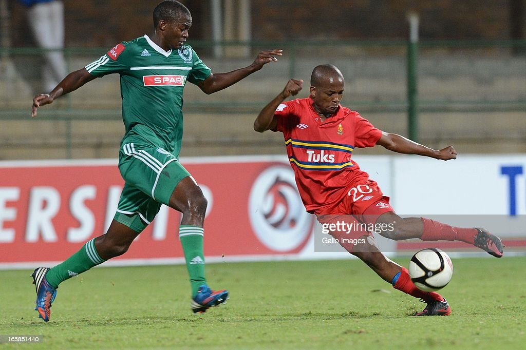 Willem Mwedihanga tackles Aubrey Ngoma during the Absa Premiership match between University of Pretoria and AmaZulu at Tuks Stadium on April 06, 2013 in Pretoria, South Africa.
