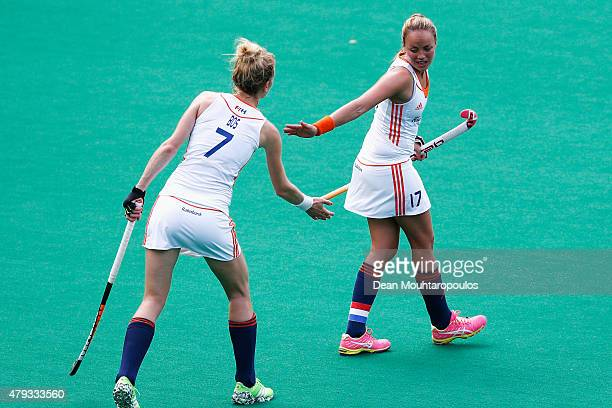 Willemijn Bos of the Netherlands congratulates Maartje Paumen after she scored a goal against Australia during the Fintro Hockey World League...