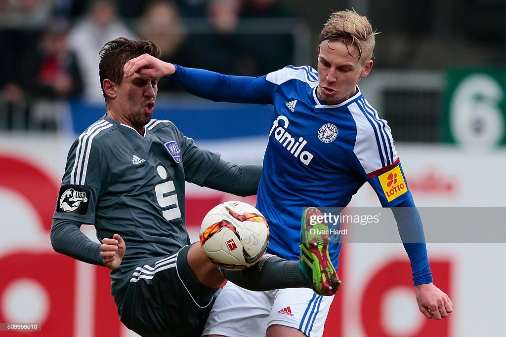 Willi Evseev (R) of Kiel and Alexandro Dercho (L) of Osnabrueck compete for the ball during the 3 liga match between Holstein Kiel and VfL Osnabrueck at Holstein-Stadion on February 13, 2016 in Kiel, Germany.