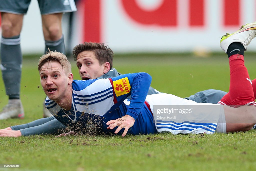 Willi Evseev (L) of Kiel and Alexandro Dercho (R) of Osnabrueck compete for the ball during the 3 liga match between Holstein Kiel and VfL Osnabrueck at Holstein-Stadion on February 13, 2016 in Kiel, Germany.