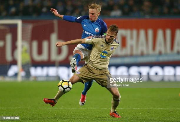 Willi Evseev of Rostock battles for the ball with Christian Gross of Osnabrueck during the third league match between FC Hansa Rostock and VfL...
