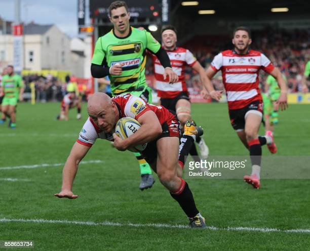 Willi Heinz of Gloucester dives to score their fifth try during the Aviva Premiership match between Gloucester Rugby and Northampton Saints at...