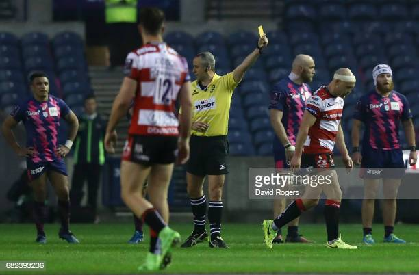 Willi Heinz of Gloucester walks off as Referee John Lacey of Ireland shows him a yellow card for a high tackle on Jules Plisson of Stade Francais...