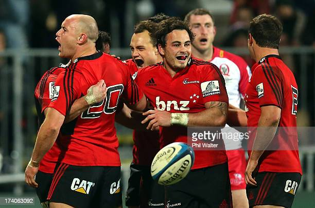 Willi Heinz of the Crusaders celebrates the try of Ryan Crotty during the Super Rugby Qualifying Final match between the Crusaders and the Reds at...